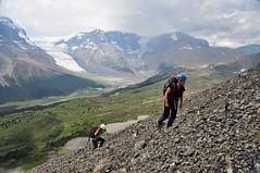 Amelie and Allana (Marko Stavric) Tags: park summer mountain canada mountains rockies nikon women jasper hiking meadow rocky august hike glacier ridge alpine national alberta amelie parkway glaciers scree poles hikers tangle icefields scramble helmets allana athabasca scrambling d90 gaiters ss123