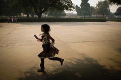 Run (Lil [Kristen Elsby]) Tags: travel india girl asia child play agra running run editorial topv9999 reportage southasia sikandra uttarpradesh travelphotography akbarthegreat akbarsmausoleum canong12 flickreditorial