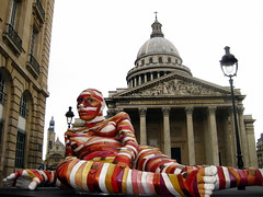 Coloured mummy resting outside Pantheon (Carlos ZGZ) Tags: 2d 75005 carloszgz ccby city colour laying momia monument mummy outdoor pantheon paris red resting sainttiennedumont sculpture statue street streetart wallpaper white woman cmstoolsphotoring fondodepantalla postal postcard cartepostale freeculturalworks openlicense creativecommons freepictures rue calle mujer femme people gente escultura estatua color couleur rojo rouge blanco blanc monumento france francia europe europa