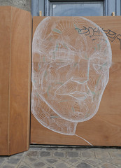 Man's face, drawn in white on a wooden construction barricade, Parie (Monceau) Tags: streetart man face drawn white wood construction barrier paris