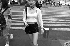 FROM W PROJECT (Alex Coghe) Tags: woman womenarebeautiful mexicocity mexico eyecontact blackandwhite leica x2 city hotpants oriental legs girl