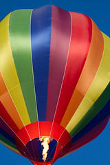 Hot Air Balloon Liftoff (Mukumbura) Tags: hotairballoon rainbow inflation inflating flight purple blue red orange yellow green wells somerset bankholidaymonday liftoff takeoff airborne flame bluesky summer technicolor bishopspalace gcelm vibrant vivid bright