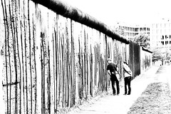 Berlin Wall - Looking through history (www.streetphotography-berlin.com) Tags: city people street travel europe urban architecture blackandwhite white black wall germany berlin deutschland streetphotography berlinwall