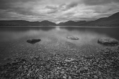Lake McDonald - Glacier National Park (michaelraleigh) Tags: trees summit landscape f28l serene highquality reflection mountains canoneos5dmarkii 2035mm canon sky infocus clouds secluded shadows summer national silhouette beautiful mountain dark montana lake outdoors park bw blackandwhite glacier gray