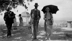 Their royal highnesses the Duke and Duchess of York enjoy a morning at Mt Coot-tha, April 1927 (State Library of Queensland, Australia) Tags: duchess duke york cloche library queensland garden umbrella tour 1920s mtcoottha australia fedorahat dropwaisteddresses gazebo englishroyalty britishroyalty brisbane statelibraryofqueensland panoramicviews royalvisit englishmonarchy britishmonarchy brisbanebotanicalgardens 1927 parasol slq handbags pleatedskirt cameracase ladieshats waistcoat suit neckties scarf gloves vista landscape maryjaneshoes