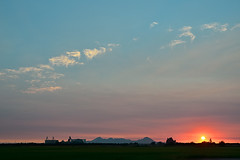 sutter buttes. marysville, ca. 2012. (eyetwist) Tags: california sunset postprocessed silhouette forest photoshop landscape fire saturated nikon exposure rice farm filter smokey fields sutter backlit norcal agriculture nikkor capture northern processed marysville sutterbuttes buttes postprocessing yuba alienskin eyetwist nx2 d7000 capturenx2 eyetwistkevinballuff nikond7000 18200mmf3556gvrii