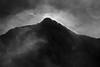 Mountain Glow (cormend) Tags: mountains fog alaska clouds canon airplane landscape eos flight 50d cormend