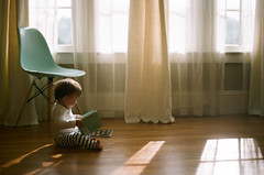 little reader (*Cinnamon) Tags: baby film 35mm nikonf100 kodakportra160 planetolive