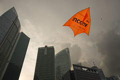 Big kite (Andrew Tan 2011) Tags: sky orange silhouette skyline clouds grey singapore kites backlit kiteflying ntuc oue thechallengefactory thepromontory grandflyingdays