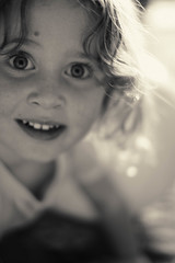 Happiness (Quantum Zen) Tags: portrait blackandwhite bw eye kids bokeh highcontrast xpro1 fujixpro1 fujifilmxpro1 fujinon35mmf14 fujifilmxpro135mmf14