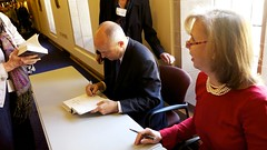 Michael Duffy and Nancy Gibbs signing books