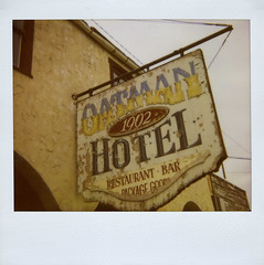 Oatman Hotel (Nick Leonard) Tags: wood old arizona history classic film beautiful sign bar analog vintage polaroid restaurant hotel wooden route66 painted gorgeous nick letters scan historic retro signage font polaroidspectra timeless expiredfilm oatman 1902 packagegoods instantfilm imagefilm epson4490 spectrafilm polaroidspectrasystem oatmanhotel integralfilm nickleonard type1200 expired2009 believeinfilm