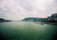 Budapesti. (heavymetalvomitparty) Tags: bridge color film train 35mm river europe mine hungary budapest statues eastern travelphotos hillsides budapesti