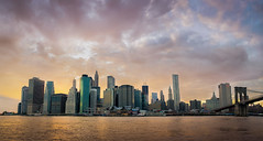 Golden September in New York City (Josh Liba) Tags: city newyorkcity bridge sunset newyork green water glass skyline architecture modern brooklyn clouds lights golden evening nikon shiny skyscrapers purple widescreen famous wide september hues majestic 169 magichour goldenhour 16x9 2011 d7000 35mmf18g