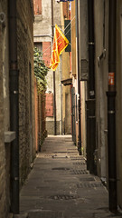 Calle in summer, Caorle, Veneto, Italy (Eilis88) Tags: caorle mare sea veneto italy street calle vicolo halley alley flag summer small town history architecture