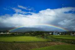 Rainbow at the end of the summer (jasohill) Tags: landscape amazing nature spectrum city 2016 iwate red summer colorful rainbow hachimantai photography violet sky fields clouds life japan rice