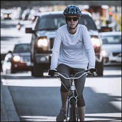 Leading the way (Dan Dewan) Tags: centretown dandewan bicycle canon7dmarkii canonef70200mm14lisusm street canon fall september colour cyclist ottawa sunday portrait  woman photographist ontario bankstreet glasses lady 2016 bike