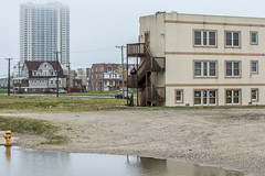 Abandoned Atlantic (roevin | Urban Capture) Tags: atlanticcity newjersey unitedstates us casino casinos street houses decay residential juxtaposition block haze yard door constructions housing neighboorhood electricity wires porch brick abandoned puddle water reflection house empty