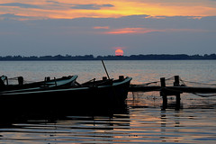 Fishing boats at dusk (marcomes) Tags: sunset sun reflection water landscape boats nikon tramonto dusk barche tuscany laguna nikkor toscana 70300mm orbetello d90