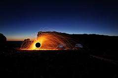 Holes (Zircon_215) Tags: lightpainting dusk holes thearches greatnorthernpeninsula naturalrockformation nikond300 noctography thearchesprovincialpark burningsteelwool