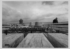 Waiting For The Storm (Tjook) Tags: wood white black men by ferry clouds composition design boat photo waiting looking symmetry experience tables editorial handrail ashtray railing danmark planks banks flowerpots photodesign horison photoexperience tjook