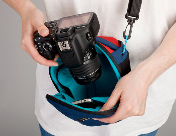 Easy access to your DSLR camera, with pocket for mobile phone