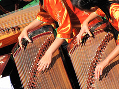 Chinese Musicians on Zheng (shaire productions) Tags: street ladies girls summer people urban musician music playing girl festival musicians youth asian oakland community chinatown image candid stage traditional chinese performance performing young culture event instrument gathering strings tradition harp fest instruments cultural imagery streetfestival oaklandchinatown zheng guzheng stringed halftubezither oaklandchinatownstreetfest pluckedstrings