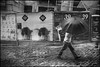 Fado XXII: Self Prevention (Sator Arepo) Tags: leica portugal rain umbrella 35mm advertising poster streetphotography rangefinder billboard hoarding porto rainy mf protection summilux prevention ff oporto m9 pavestones preasph leicam9