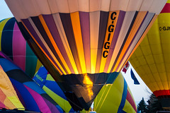 Warming Up (djking) Tags: alberta cgigc canada heritageinninternationalballoonfestival highriver hotairballoons flame