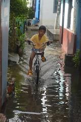 boy on a bicycle (the foreign photographer - ) Tags: boy bicycle flood water khlong lard phrao portraits bangkhen bangkok thailand nikon d3200