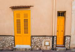 61/63 (Emykla) Tags: door giallo yellow sicilia sicily italia italy 61 63 terrasini palermo nikon d3100 wall muro flickr photo foto double doppio due two 2