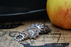 Get It In Gear, K.... (Little Hand Images) Tags: gears washers bowlerhat apple steampunkpaper closeupphotography airship