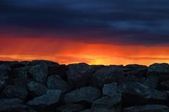 Sunset on the rocks (beyondhue) Tags: sunset sky orange cloud sun ontario canada beach nature rock river dark ray ottawa gray walkway drama britannia summet beyondhue