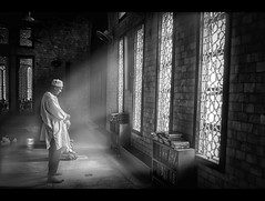 The enlightened one. (Shutterfreak ☮) Tags: windows light people monochrome nikon afternoon floor candid muslim praying documentary oldman books mosque textures tiles rays dhaka ramadan shelves bangladesh enlightened hasin d5000 inkiad