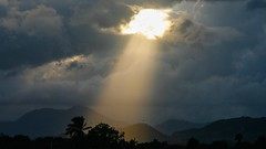 Ray of Light on Cap Haitien, Haiti (Alex E. Proimos) Tags: light sunset sun mountain luz birds clouds haiti heaven ray afternoon christ god religion jesus over palm hills beam stunning biblical theoriginalgoldseal