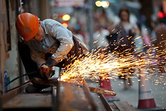Busy Working (Drjones266) Tags: china street hat construction iron welding working hard streetscene beam torch cutting sparks mongkok ironworker plasmacutter hongkongchina cuttingiron