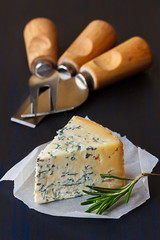 Blue cheese. (ZakariaSnow) Tags: blue food green yellow closeup cheese cuisine natural background fat board traditional knife goat tasty fork fresh gourmet delicious slice snack rosemary meal cutting appetizer mold diet dairy piece product herb roquefort stilton nutrition gorgonzola ingredient