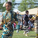 Young women compete in the Jingle Dance - called that because the metal ornaments on the costumes jingle and rattle - at the Akwesasne Pow Wow on Sunday.  Photo: David Sommerstein.