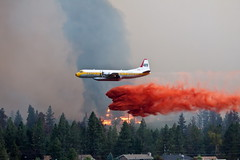 Trepanier Fire 19 (LongInt57) Tags: trees houses red orange house canada tree green forest airplane fire fly flying bc okanagan aircraft smoke flames airplanes structures structure flame valley forestfire firefighting bomb bomber fires forests bombing bombers wildfire fireretardant