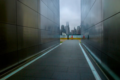 Dreaming of NYC (SunnyDazzled) Tags: city sky newyork fog skyline evening newjersey construction memorial stainlesssteel sailing ship cityscape skyscrapers cloudy manhattan foggy tourist names legacy lowclouds engraved libertystatepark freedomtower emptysky