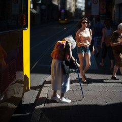 37C / 99F (tavekapa) Tags: old summer woman hot color colour lady square 50mm nikon warm downtown shadows candid 14 streetphotography sigma elderly heat suffering 1x1 farenheit stronglight macadam celcius 500x500 d700 37c99f