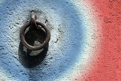 Rusty Ring With Added Colour (MarkUK97 (catching up)) Tags: old blue shadow red white france colour texture wall circle rust colours circles rusty ring coloured melle poitoucharentes