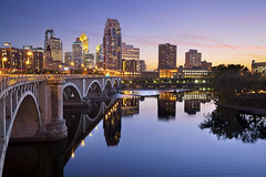 City of Minneapolis. (Rudi1976) Tags: city bridge blue sky usa reflection tower water minnesota skyline architecture night skyscraper river outdoors town streetlight cityscape arch dusk citylife minneapolis officebuilding mississippiriver northamerica urbanscene traveldestinations famousplace buildingexterior internationallandmark downtowndistrict builtstructure