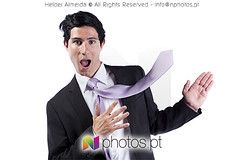 Businessman showing the copyspace with his necktie (nphotos.pt) Tags: boss portrait white man male face up smart smiling businessman youth standing happy marketing fly flying cool message looking dynamic adult action expression contemporary space joy ad young handsome lifestyle advertisement professional business suit attitude worker presentation concept copyspace satisfaction cheerful gesture excitement executive showing success isolated confident necktie active shouting career elegance caucasian advertise vitality handraised lookingatcamera salesoccupation expressingpositivity