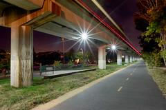 BART Passing (Ron Rothbart) Tags: bart california elcerrito npy elevatedtracks night nightphotography starburst train