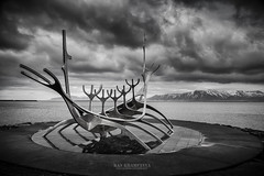REYKJAVIK, ICELAND - April 03:  Solfar sculpture (Sun Voyager) in Reykjavik, Iceland in Black and white on April 03, 2014. It is located by Sbraut, by the sea in the centre of Reykjavk, Iceland. (Kanonsky) Tags: aluminium art attraction beautiful capital europe gunnar harbor iceland landmark metal monument mountain ocean reykjavik sculpture sea ship sky solfar sun travel vikings voyager water waterfront