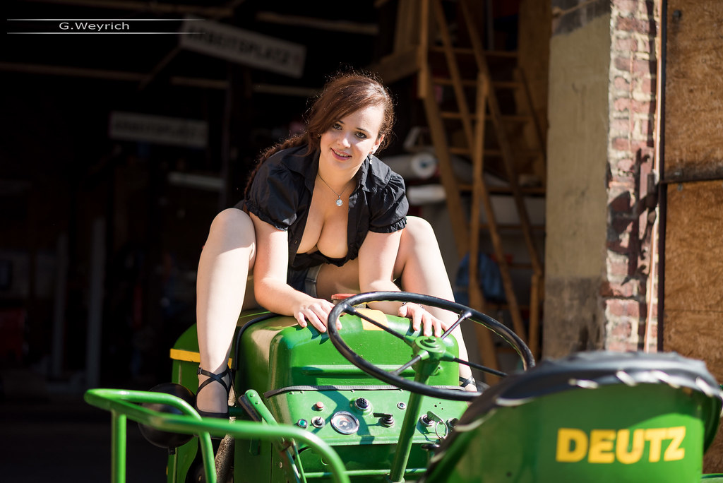 Sexy girl on tractor