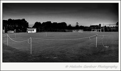 A Ropey Looking Fence HFF (M Gardner Photography) Tags: fence hff happyfencefriday mono blackandwhite cricketsquare sportsfield sportsground field