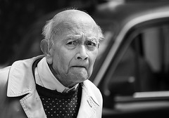 unexpected... (White_V) Tags: street portrait man london look car canon eyes candid taxi wb elderly surprised unexpected 2012 whiteandblack