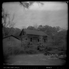 Lost to Time (dsfdawg) Tags: old white black history mill abandoned 120 film broken water rural ga vintage river georgia holga rust ruins decay south country rustic ruin historic southern abandon forgotten historical weathered ilford boarded gristmill grist 120n oldsouth bygone dsfotography dsfdawg